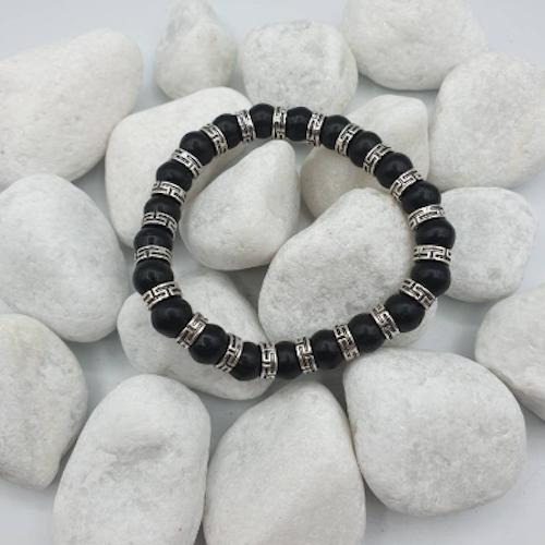 Tungt Black Jade med antik-silverfärgade distanser