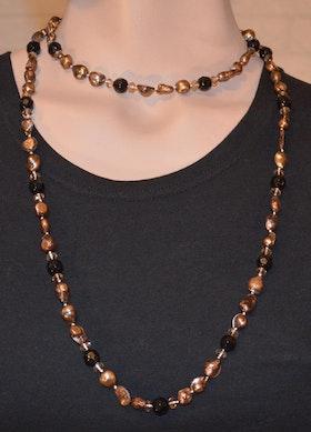 Pärlhalsband brun