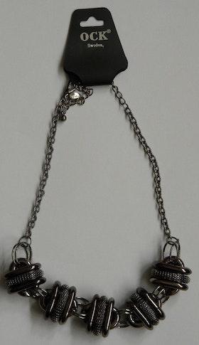 Fräckt halsband i oxiderat svart