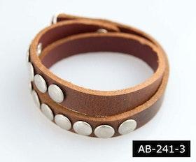 Armband för båda med nitar