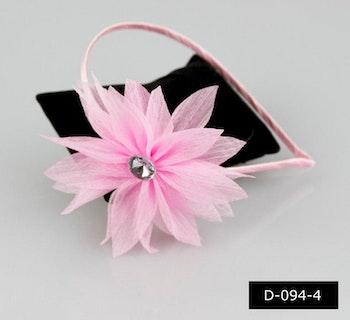 Diadem med rosa blomma