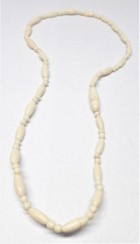 Kort halsband med rundade stavar