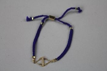 Handgjort armband i blått tyg och guld, Ettika design, California