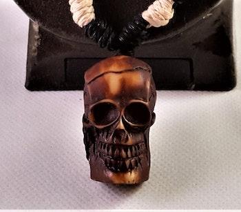 Halsband med brun dödskalle