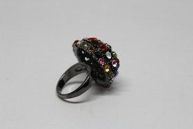 Ring i flera glittriga färger