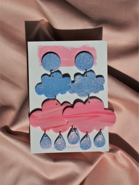 Dubbla regnmoln med glittermåne