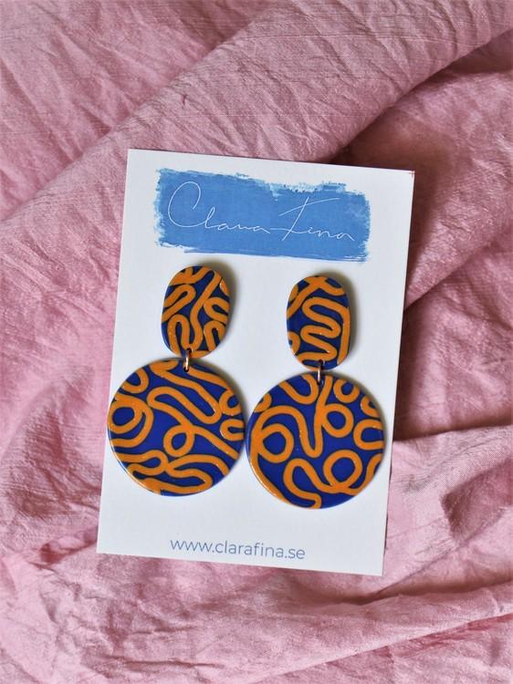 Inte helt rund dubbelprick orange och blå