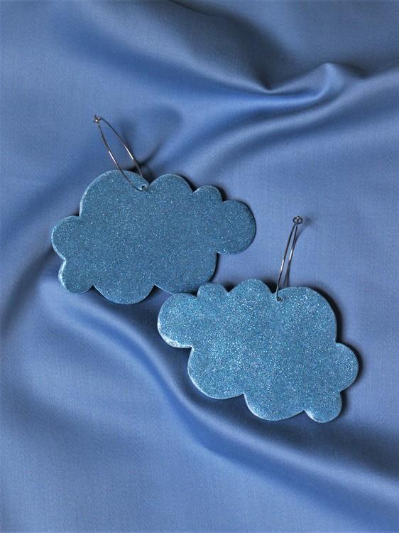 Stora moln på ring blått glitter