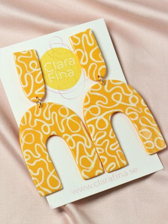 Arch M gul och vit