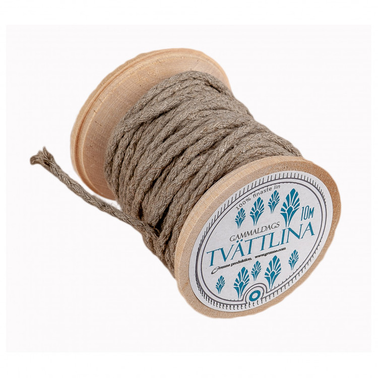 Gammaldags tvättlina av linsnöre