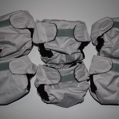 Hemmasydda pockets för nyfödd