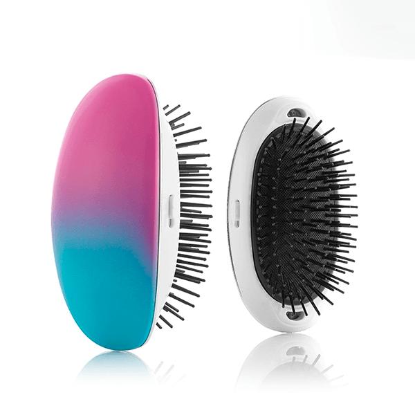 Batteridriven hårborste för tovor, släpper negativa joner med en vibrerande massage