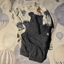 Vit body med luftballonger i blått och vinrött samt ett par finare fodrade byxor från Newbie stl 62