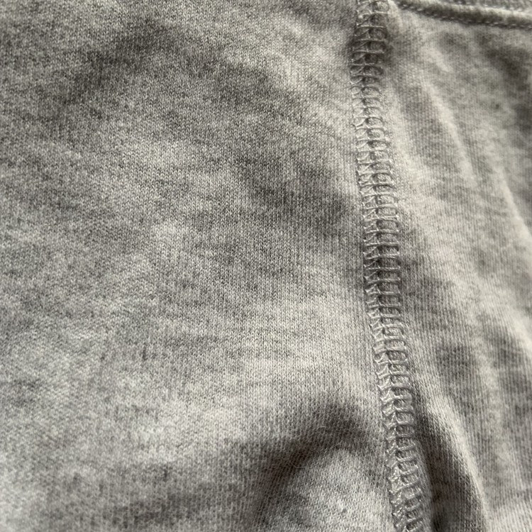 Gråmelerade byxor med fötter från HM stl 50