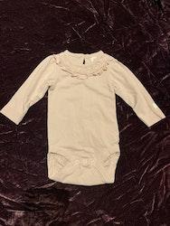 Gammelrosa body med spets och volang från Newbie stl 56