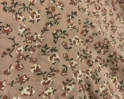 Rosa byxor med blommönster i rosa, vitt och grönt från Newbie stl 56