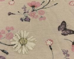 Ljusrosa klänning med blomster- och fjärilstryck från Lindex stl 56
