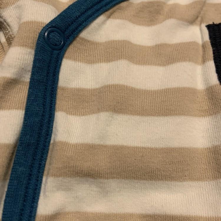 Vit och beigerandig omlottbody med detaljer i blått och svart från PoP stl 62