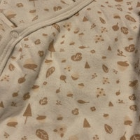 Vit omlottbody med gammelrosa mönster från Ica Eco st med fjärils tryck stl 62
