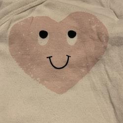 Vit omlottbody med hjärtmönster från HM stl 62