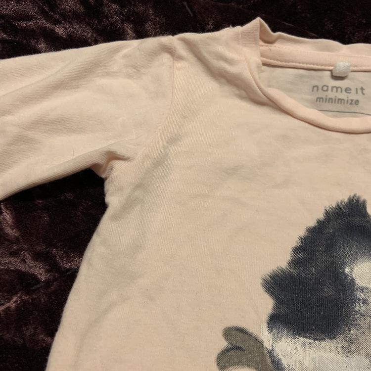 Ljusrosa body med grått fågeltryck från Name It stl 62