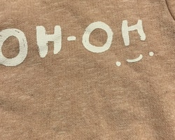 Rosamelerad tröja med vit text från Zara stl 62