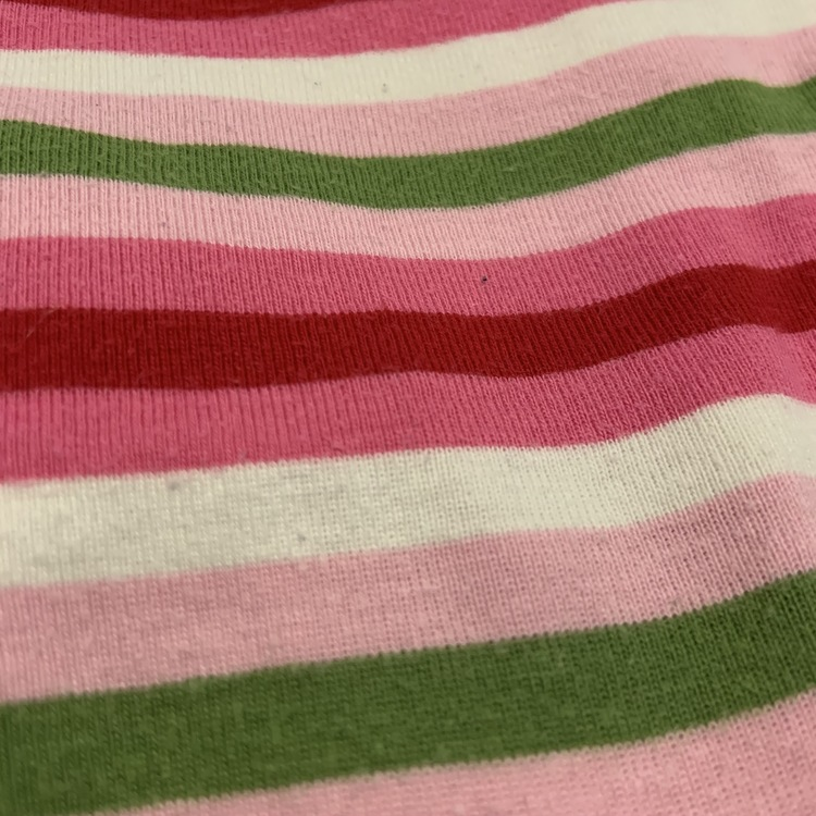 Flerfärgat randig body med Bamse tryck från Lindex stl 56