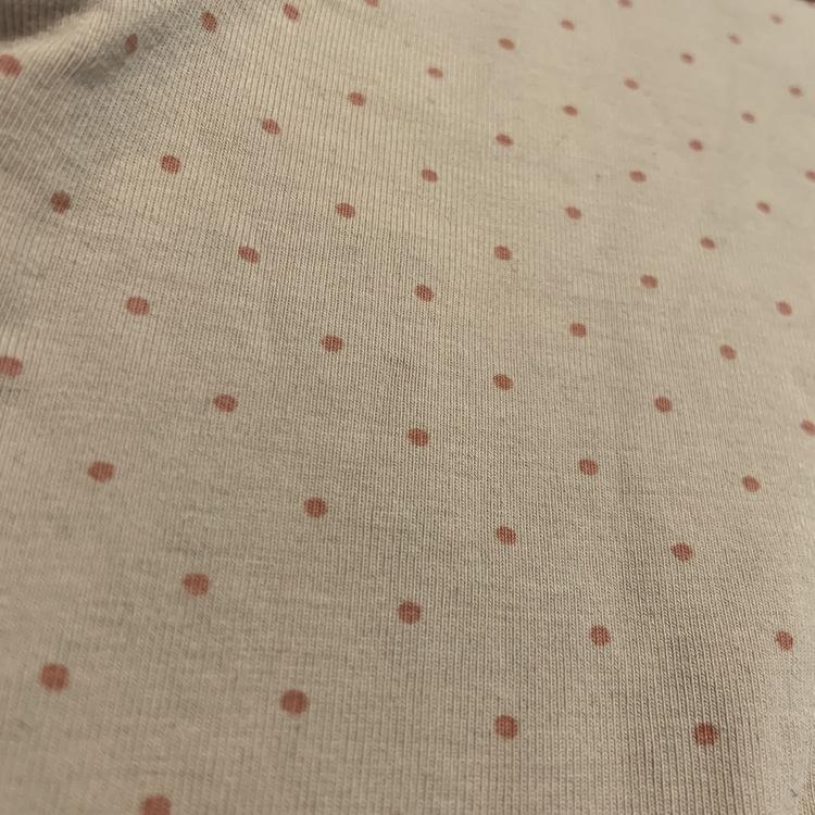 Dovt rosalila body med rosa prickar och kantband från Lindex stl 56