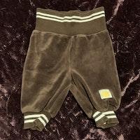 Bruna byxor med vita ränder från Kaxs stl 56