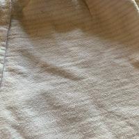 Vita byxor med ljusrosa muddar och ränder från HM stl 62
