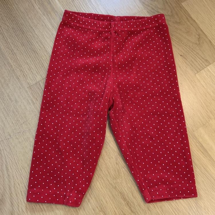 Röda byxor med vita prickar från Fix stl 62