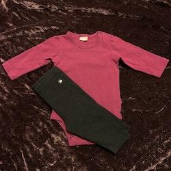 Set med mörkrosa body och svarta leggings från Lindex stl 62