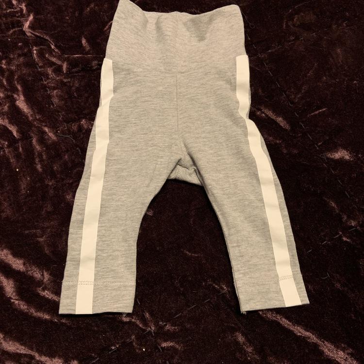 Set med body med tryck och leggings med revärer från HM str 62