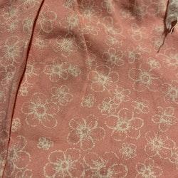 Rosa byxor med vitt blommönster från Name It str 62
