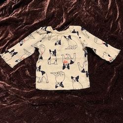 Vit tröja med mönster av svartvita frallor med rosa detaljer från HM stl 62