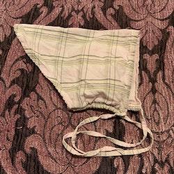Schalett mössa i rosa rutigt från HM stl 62
