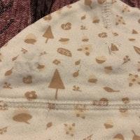 Vit mössa med rosa natur mönster från Ica Eco stl 62