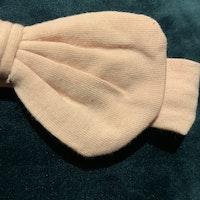 Ljusrosa hårband med rosett