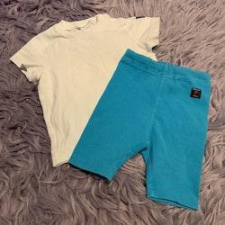 Set med vit t-shirt och turkosa shorts från PoP stl 68