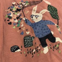 Rosa tröja med kanin tryck och grå byxor med rosa prickar från Lindex stl 68