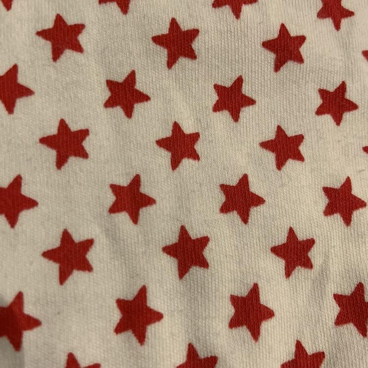 3 delat paket från Mini bestående av tre överdelar i vitt, svart och rött stl 68