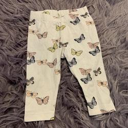 Vita leggings med fjärilsmönster från Lindex stl 68