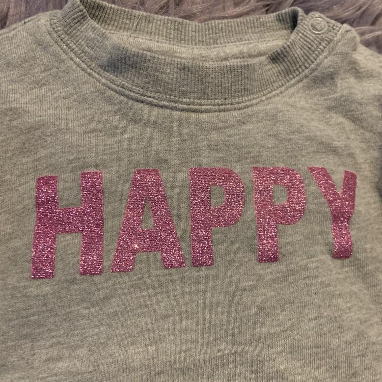 Grå collegetröja med rosaglittrigt texttryck från Made with love stl 68