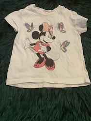 Vit t-shirt med Mimmi tryck och rosa rutiga leggings från Disney HM stl 74