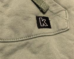 Gröna byxor med stor ficka från Kaxs stl 74