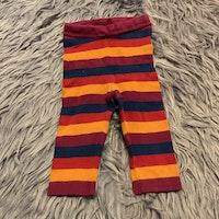 Fyrfärgade randiga stickade leggings från PoP str 74
