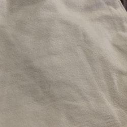 Vit body med volang kring halsen från Newbie stl 56