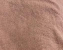 Rosa ärmlös body med volanger från Newbie stl 56
