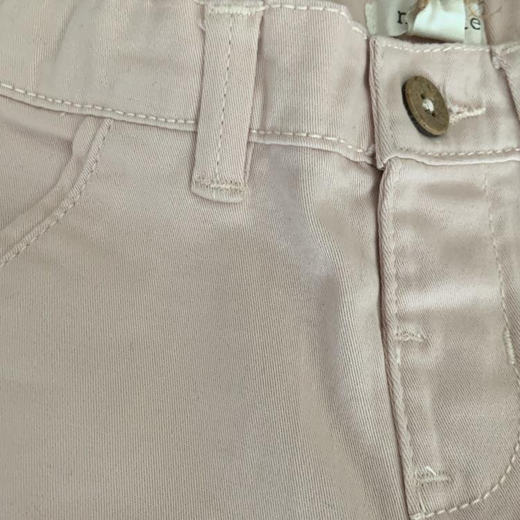Ljusrosa byxor från Newbie stl 62