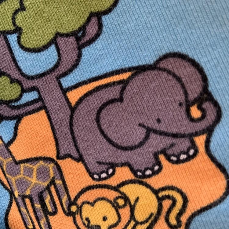 Ljusblå tröja med färgglatt djurtryck från PoP stl 86
